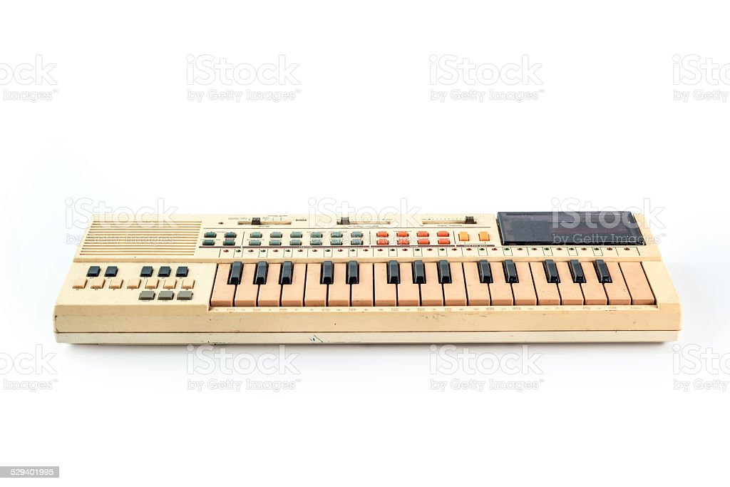 Old vintage synthesizer isolated on white stock photo