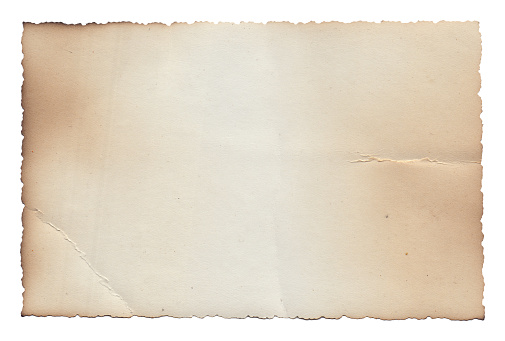 Old vintage rough texture retro paper with burned edges, stains and scratches background
