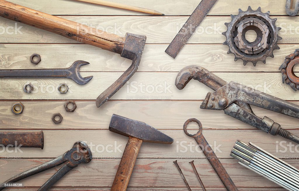 Old vintage tools on wooden table. stock photo