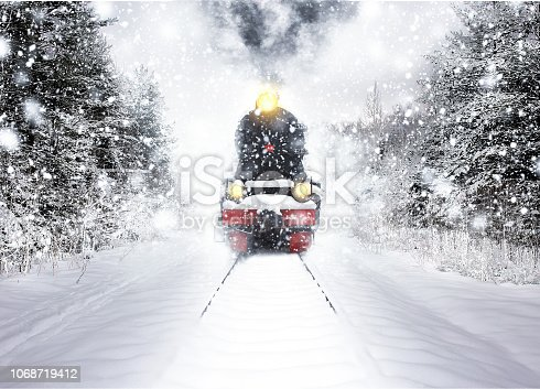 Winter snow forest train ride in winter snow forest. Fairy tale winter landscape. Rails covered with snow