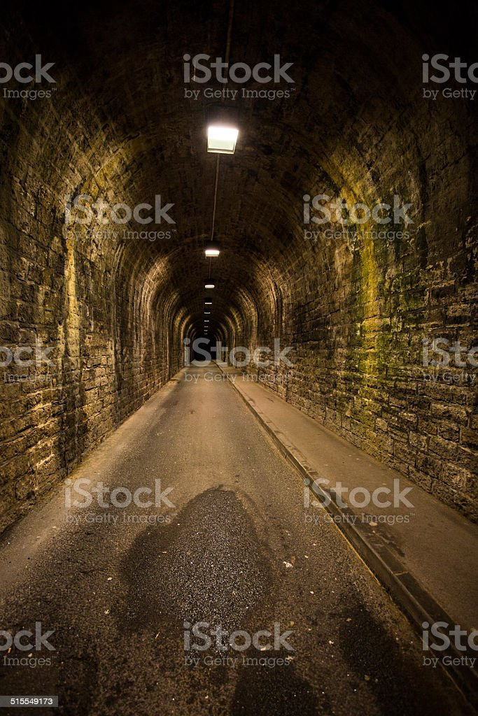 Old vintage tunnel in Biarritz at night stock photo