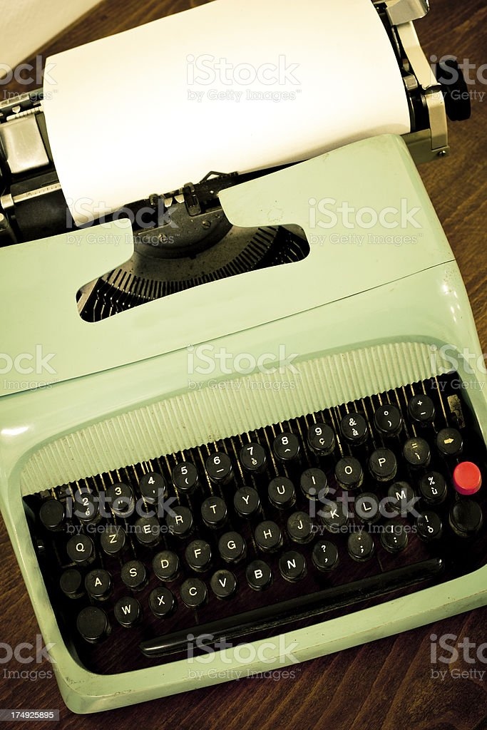 Old Vintage Typewriter and White Sheet of Paper royalty-free stock photo