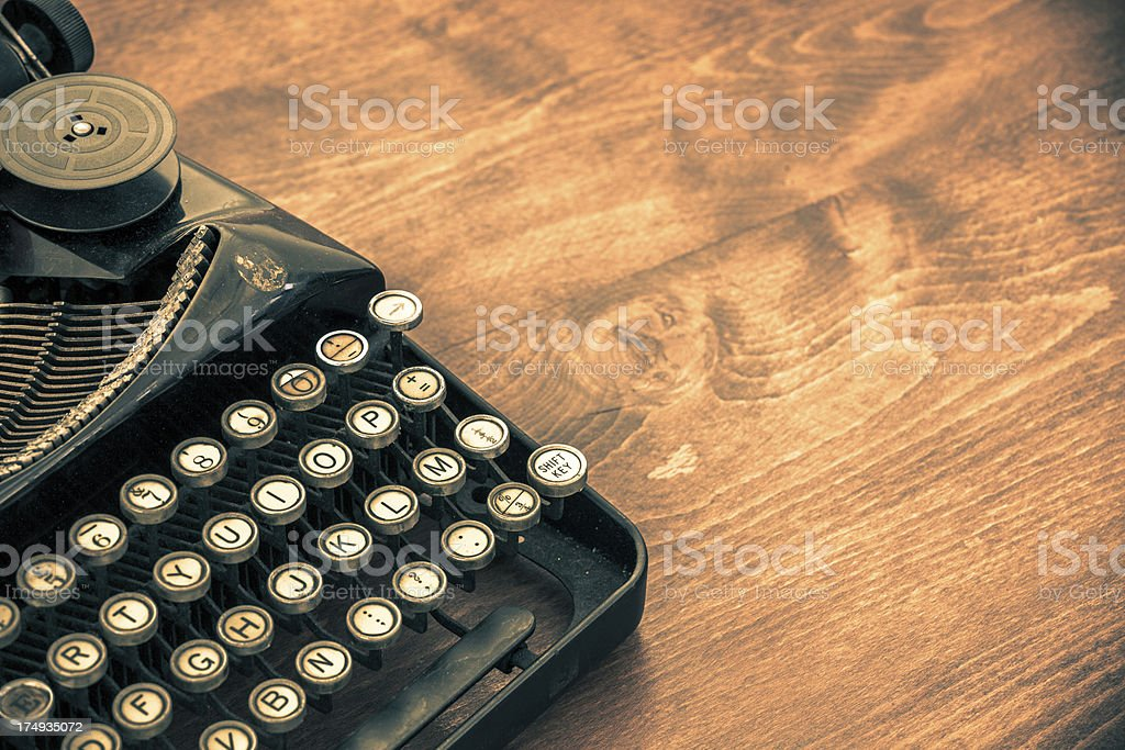 Old Vintage Typewriter on Wood Table with Copy Space stock photo