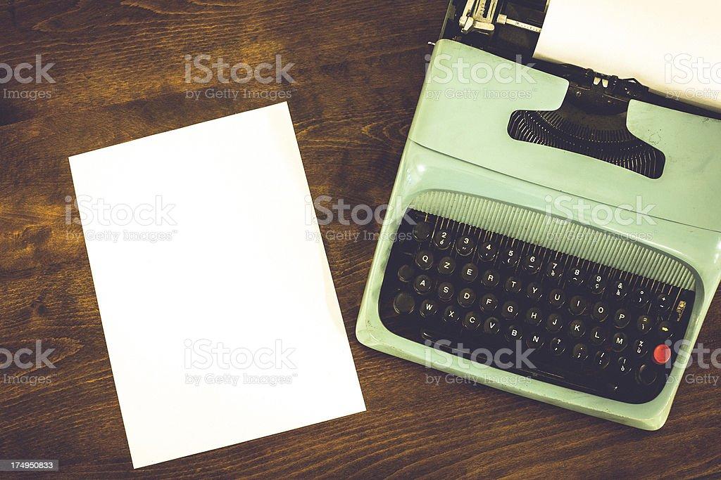 Old Vintage Typewriter with White Sheet of Paper royalty-free stock photo