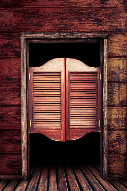 Old vintage wooden saloon doors Old western swinging Saloon doors saloon stock pictures, royalty-free photos & images