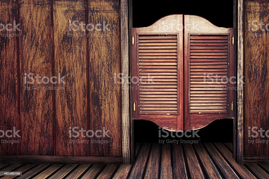 Old vintage wooden saloon doors stock photo