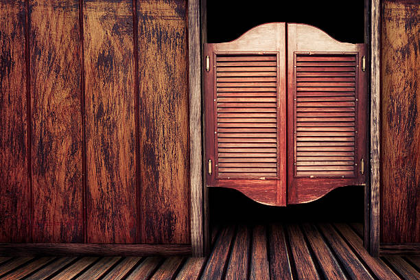 old vintage wooden saloon doors - wild west stock photos and pictures