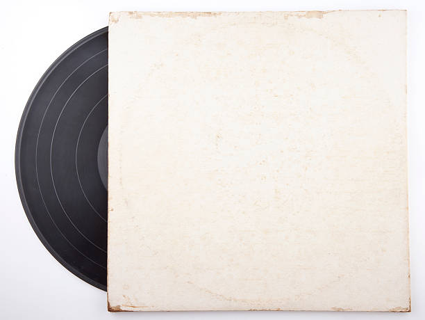 old vinyl record in a paper case - records stock photos and pictures