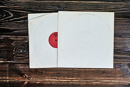 old vinyl record in paper cover