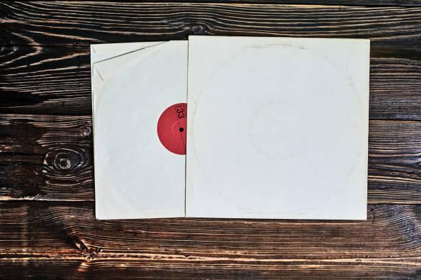 old vinyl record in paper cover - coprire foto e immagini stock