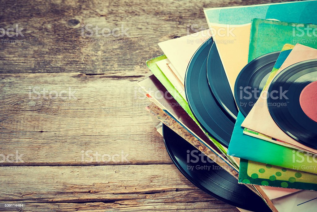 Old vinyl record on wooden background. stock photo