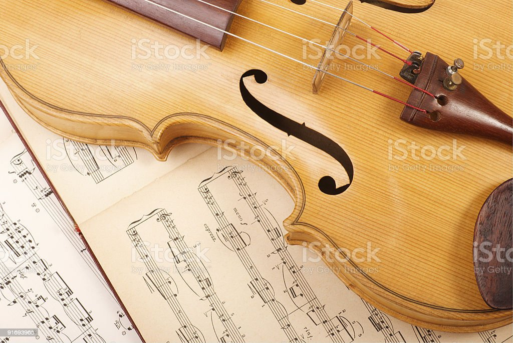 Old viola and vintage music sheet royalty-free stock photo
