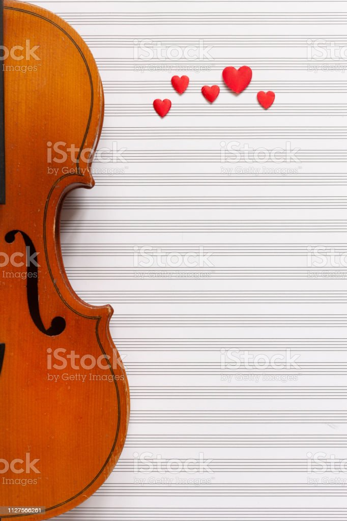 Old Violin And Red Heart Figurines Top View Close Up Flat