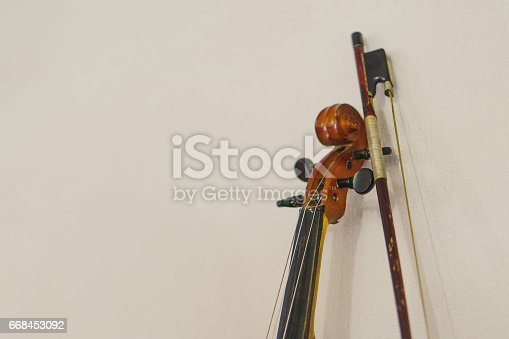 istock old violin detail on paper with copy-space 668453092
