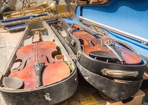 istock Old violin instrumen on market place. 1160200158