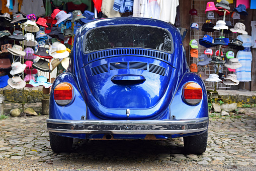 Palenque, Mexico - 3rd January, 2018: Old blue Volkswagen Beetle parked on the bazaar. This model was the most popular vehicle in the world.