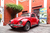 Arequipa, Peru - October 16, 2015: Front and side view of a red Volkswagen Kaefer