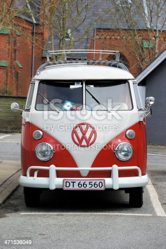 Nykoebing Mors, Denmark - May 10, 2013: Vintage Volkswagen Transporter parked in the street. Old town houses in the background.