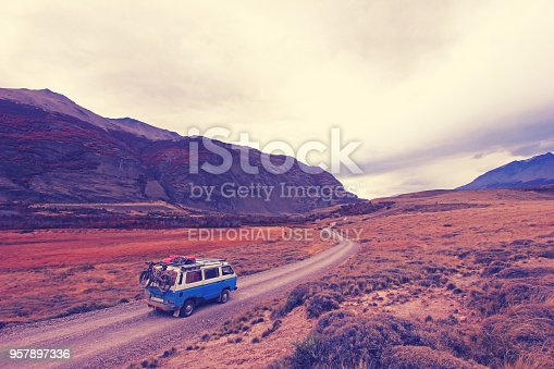 istock Old Volkswagen vintage campervan beautiful landscape near Paso Roballos, Nashville vintage photo filter effect, warm color temperature, Argentina 957897336