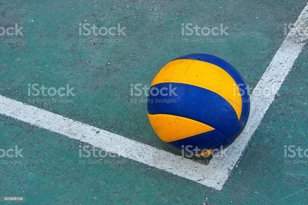 Old volleyball on a dirty court stock photo