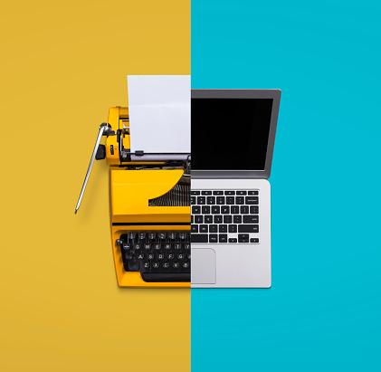 Typewriter versus laptop computer concept old vs new