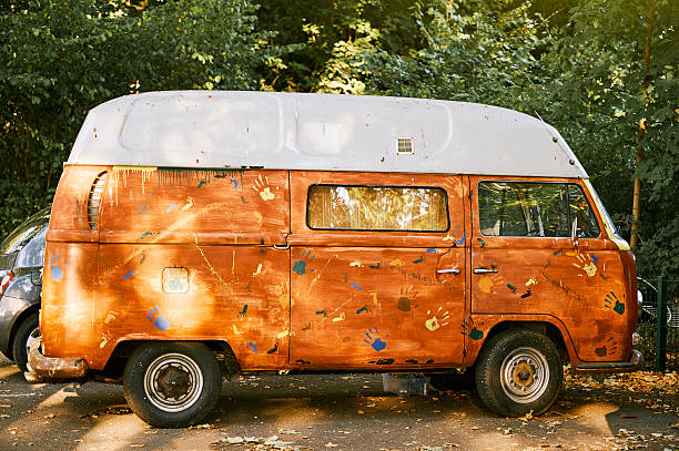 old vw camper van parked painted hand-made - hippie wohnkultur stock-fotos und bilder