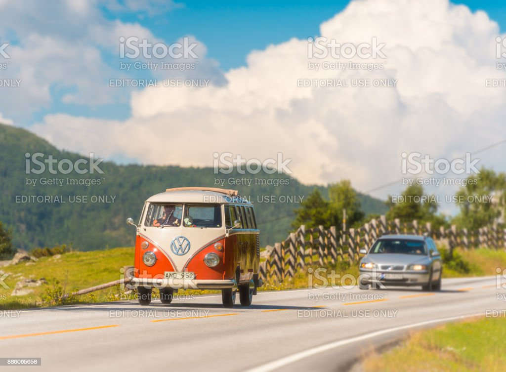 old VW red and white camper van car on country road in Norway stock photo