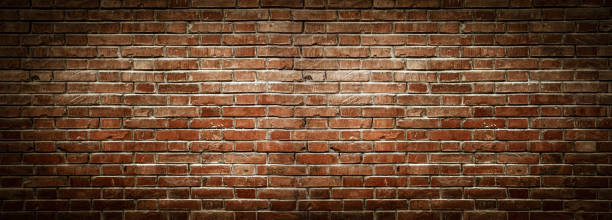 Old wall background with stained aged bricks stock photo