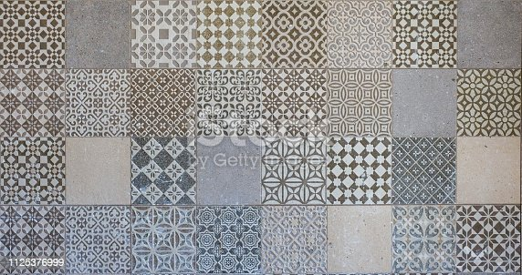926058102 istock photo Old wall ceramic tiles patterns handcraft from thailand parks public 1125376999