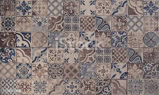 926058102 istock photo Old wall ceramic tiles patterns handcraft from thailand parks public 1125377009
