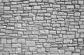 old wall from a stone brick of gray color