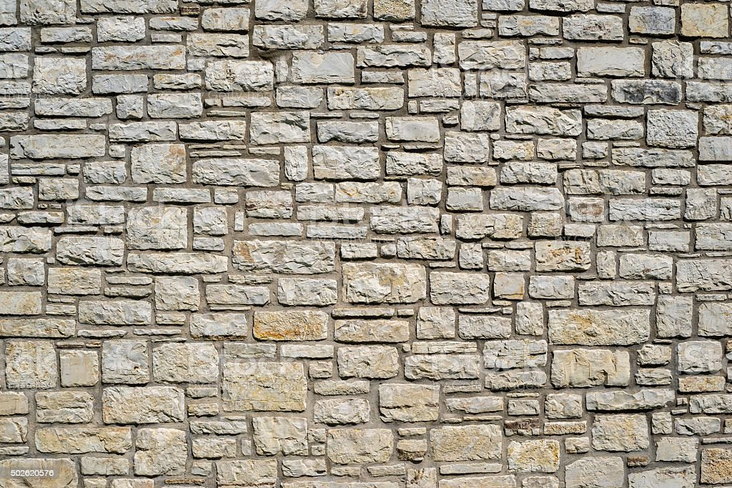 old wall from a stone brick stock photo