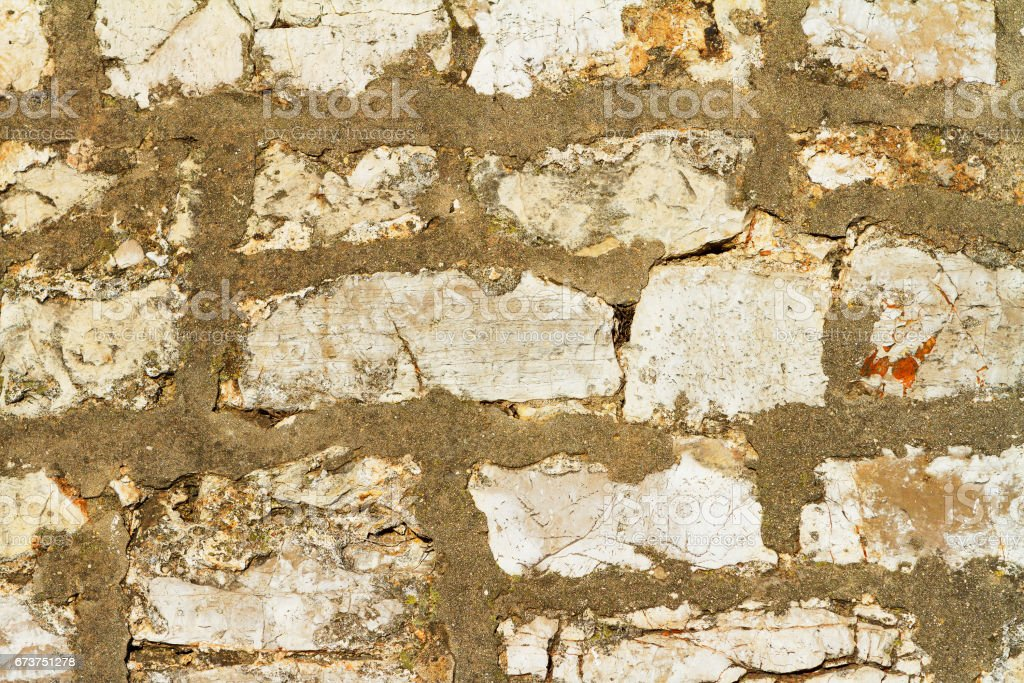 Old wall made of stone and concrete, background royalty-free stock photo
