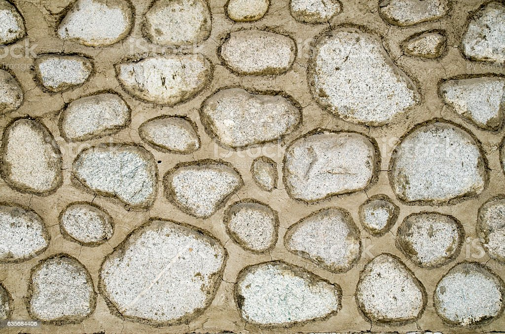 Old wall of large rounded boulders with white joints stock photo