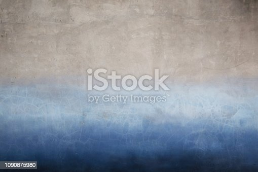 istock Old wall surface in two tone color with blue and grey. 1090875980