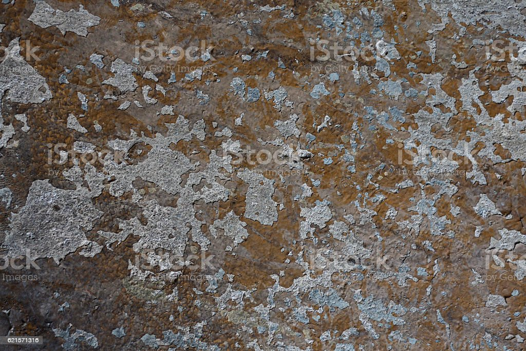 Old wall with paint peeling off. Architectural object needing renovation. stock photo