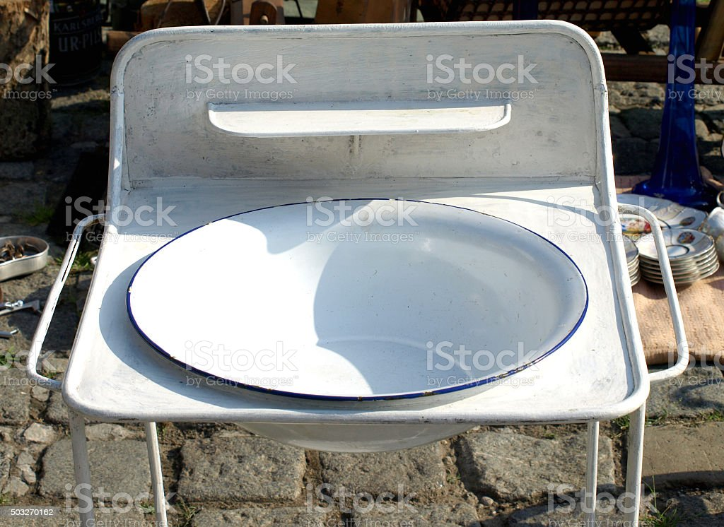 Old wash basin on a stand stock photo