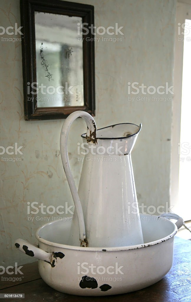 Old washbowl and can stock photo