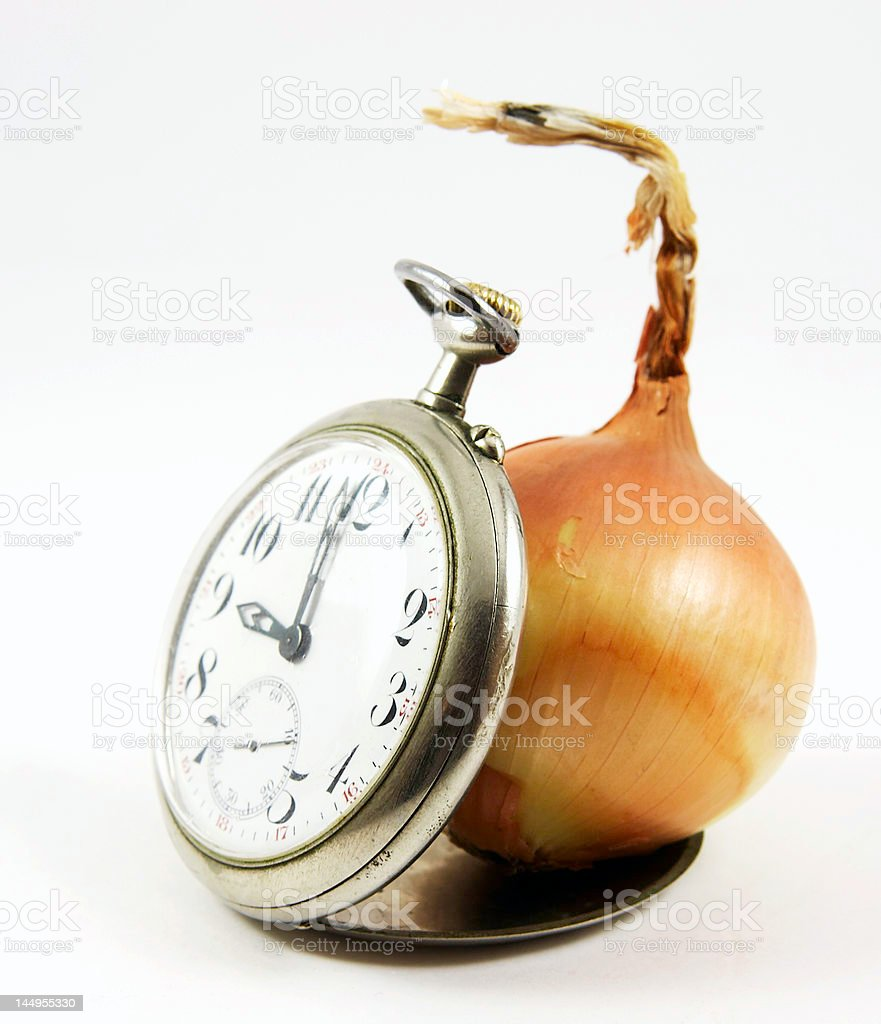 Old watch and onion isolated royalty-free stock photo