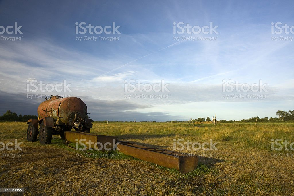 Old water cart in the field stock photo