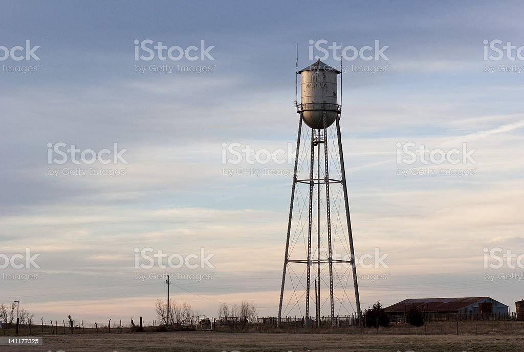 Old water tower at sunset in small U.S. town royalty-free stock photo