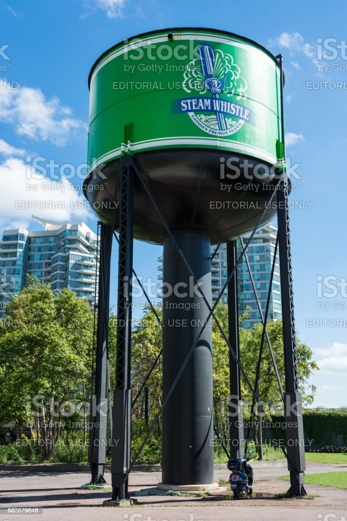 Old water tower in Toronto with logo of Steam Whistle beer brand stock photo