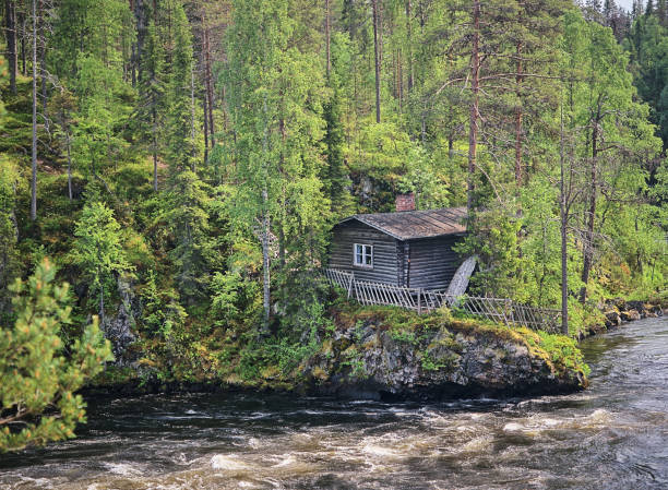 Old watermill and the fast-moving Myllykoski rapids at the Oulanka National Park stock photo