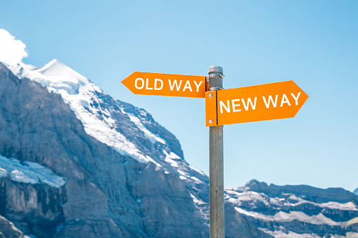 Old way or new way choice text panel with snowy mountain background. Change challenge innovation business concept