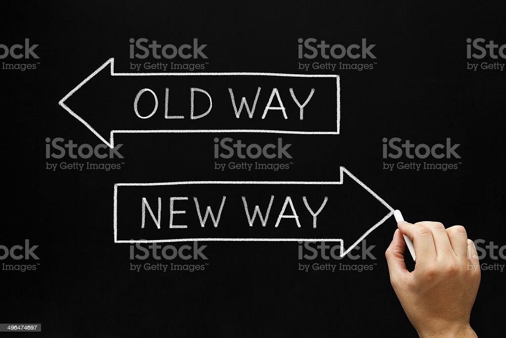 Old Way or New Way Hand drawing Old Way or New Way concept with white chalk on blackboard. Arrow Symbol Stock Photo