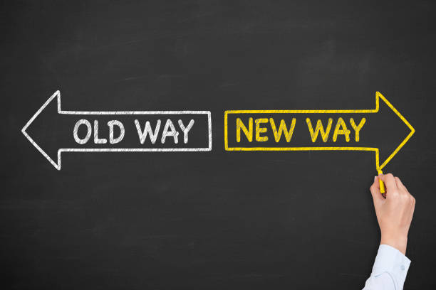 Old Way or New Way with Arrows Symbol on Blackboard Background stock photo