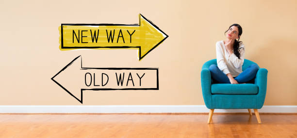Old way or new way with woman in a thoughtful pose stock photo