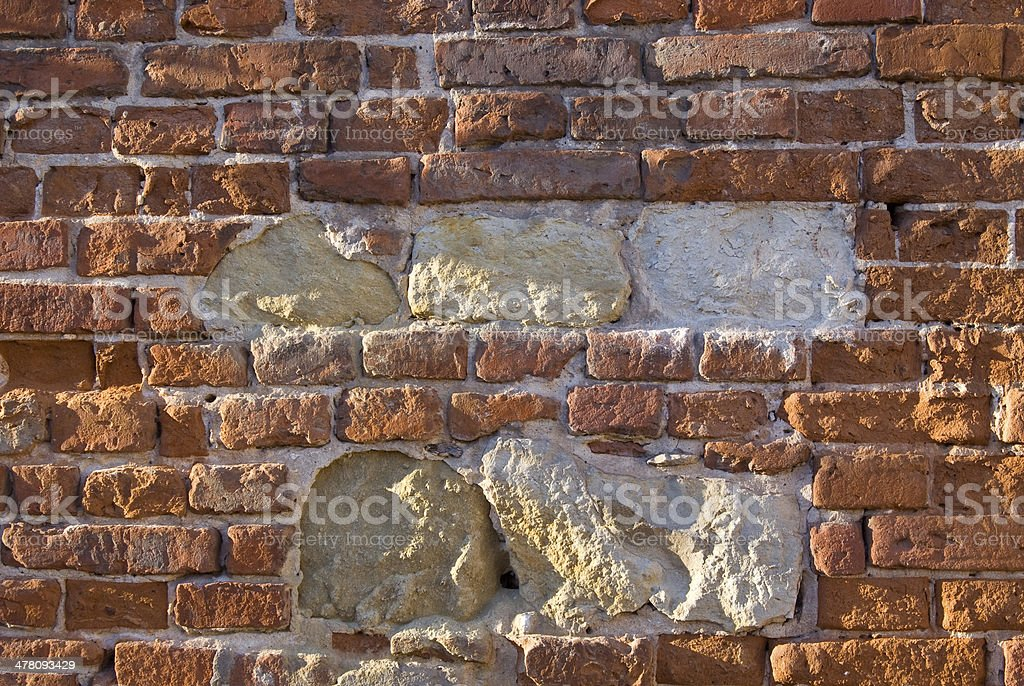 Old weathered brick wall fragment . royalty-free stock photo