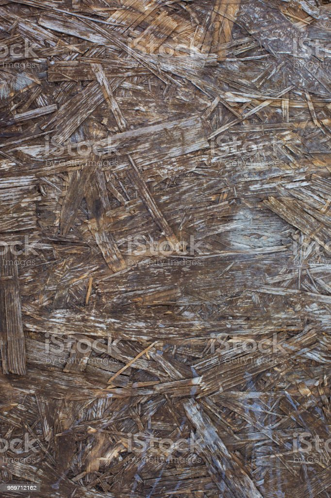 Old weathered chipboard texture close-up stock photo