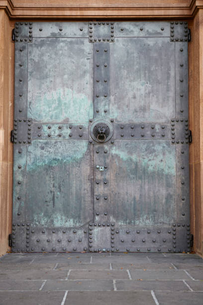 Old weathered church door with rivets stock photo